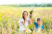 Family having fun outdoors in summer park — Stock Photo