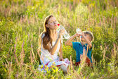 Family drink water from plastic bottles — Stock Photo