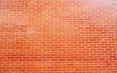 Fond et texture de mur de brique orange vieux — Photo