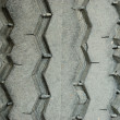 Close up on the old dirty tire foot print background — Stock Photo #31973499