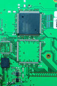 Close up on a part of the old electronic circuit boards backgro — Stock Photo