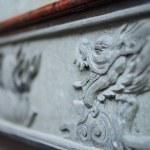 Granite craving dragon face — Stock Photo #39711737