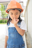 Little engineer make a nose picking — Stock Photo