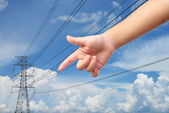 Kid hand point to the power electricity pole — Stock Photo