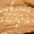 Hunter's Panel - Indian Petroglyph located in Nine Mile Canyon i - Stock fotografie