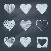 Set of hand drawn hearts on blackboard — Stock Vector