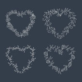 Hand drawn set of heart-shaped wreath on blackboard — Stock Vector