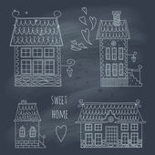 Hand drawn set of cute retro houses on blackboard — Stock Vector