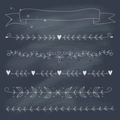 Set of hand drawn floral elements on blackboard — Stock Vector