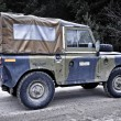 Old Land Rover Defender driving off road — Stok Fotoğraf #18905429