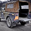 Old Land Rover Defender driving off road — Stok Fotoğraf #18905499