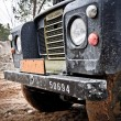Old Land Rover Defender in the mud — Stok fotoğraf