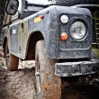 Stock Photo: Old Land Rover Defender in mud