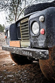 Old Land Rover Defender in the mud — Stockfoto