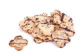 Former choklad cookies på vit bakgrund — Stockfoto