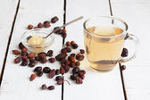 Tea from a hawthorn and dry berries — Stock Photo