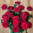Big bunch of red roses with wedding rings — Stock Photo