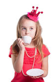 Beauty little princess with cup — Stock Photo