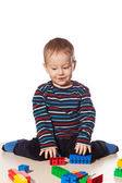 Little boy playing toy blocks isolated — Stock Photo