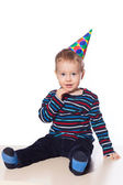 Little boy in holiday cap isolated on white — Stock Photo