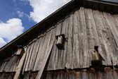 Wooden birdhouse on woodshed — Stock Photo