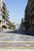 The street in Barcelona overlooking mountains — Stock Photo