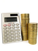 Calculator with coins — Stock Photo