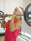 Athlete lifting weights — Stock Photo