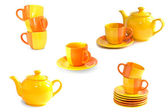 Set of colorful tea cups, teapots and saucers isolted on white — Stock Photo