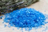 Sea salt on wooden background — Stock Photo