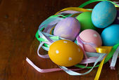 Easter eggs isolated on wooden background — Stock Photo
