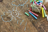 Child's drawings and coloured chalk — Stock Photo