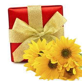 Festive gift box with flowers — Stock Photo