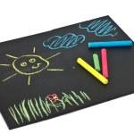 Child's drawings on blackboard — Stock Photo #24331257