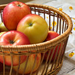 Fresh apples in bucket  on wooden background — Stockfoto