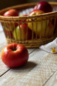Fresh apples in bucket on wooden background — Stock Photo