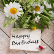 Post card with wild flowers and card with words Happy Birthday — Stock Photo
