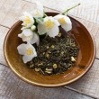 Dry herbal tea on plate — Stockfoto