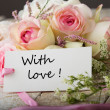 Postcard with elegant flowers and tag with phrase with love — Stock Photo