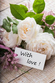 Postcard with elegant flowers and tag with words With love — Stock Photo