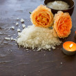 Sea salt  with rose  and candles on wooden background — Stok fotoğraf