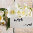 Postcard with elegant  flowers and tag with word With love — Stock Photo