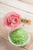Sea salt in bowl with rose . Tag with word eco. — Stock Photo