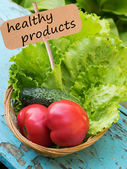 Fresh organic tomato, lettuce on wooden backgound — Stock Photo