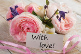 Postcard with elegant flowers and tag with word With love — Foto Stock