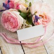 Postcard with elegant flowers and empty tag for your text — Stock Photo