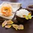 Stock Photo: Spa products. Sea salt in bowl with candle and rose