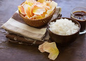 Spa products. Sea salt in bowl with candle and petals — Stock Photo