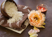 Spa products. Sea salt in bowl with candle and rose — Stock Photo