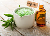 Essential aroma oil and sea salt. Tag with word organic. — Stock Photo